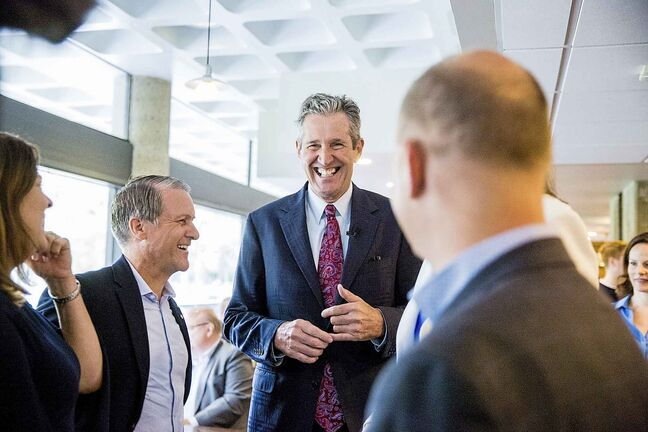 PC Leader Brian Pallister chats with candidates and supporters before presenting his costed platform on Tuesday.