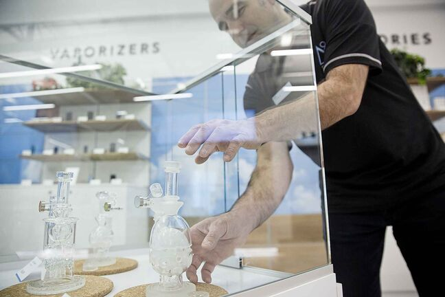 Scott Strizic, manager of the Delta 9 store on Dakota Street, with the Mothership Glass bongs, considered art pieces by many. (Mike Deal / Winnipeg Free Press)