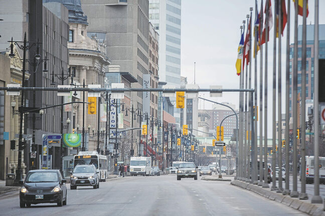 MIKE DEAL / WINNIPEG FREE PRESS Since the coronavirus hit Winnipeg, its downtown has become an area that sees very little traffic. On a Friday morning the general din of vehicles moving around has turned into a quiet, almost creepy and somewhat surreal Exchage District. Portage Ave at Main Street 200424 - Friday, April 24, 2020.