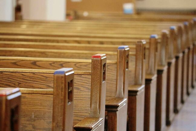 Members of St. Matthew's Cathedral in Brandon label their pews with coloured tape to help enforce social distancing now that in-person worship is making a return to the church. (Kyle Darbyson/Brandon Sun)