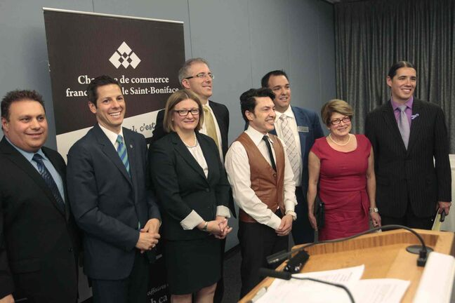 The group of seven after taking part in the Chambre de commerce francophone de Saint-Boniface mayoral debate in June, from left Michael Vogiatzakis, Brian Bowman, Paula Havixbeck, Gord Steeves, Michel Fillion, chamber president and moderator Robert Tetrault, Judy Wasylycia-Leis and Robert-Falcon Ouellette.