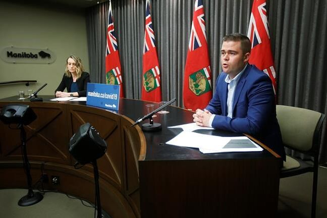 Johanu Botha, right, co-lead of Manitoba's Vaccine committee, and Dr. Joss Reimer, medical lead of the committee, speak about COVID-19 vaccination initiatives and answer media questions during a COVID-19 livestreamed news conference at the Manitoba legislature in Winnipeg on Wednesday, March 17, 2020. THE CANADIAN PRESS/John Woods