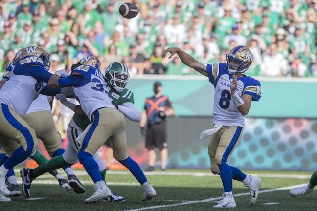 Winnipeg Blue Bombers quarterback Zach Collaros (8) throws the ball during first half CFL football action against the Saskatchewan Roughriders, in Regina, Sunday, Sept. 5, 2021. THE CANADIAN PRESS/Kayle Neis