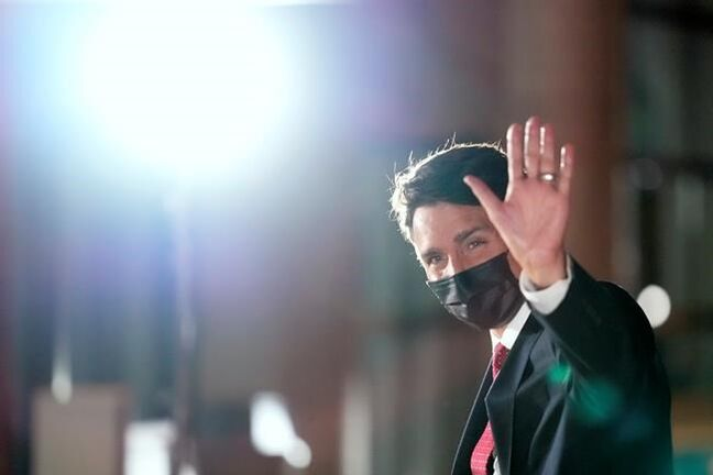 Liberal Party Leader Justin Trudeau waves to the media on arrival prior to the English language leaders' debate, in Gatineau, Que., Tuesday, Sept. 7, 2021. Canadians will vote in a federal election on Sept. 20. THE CANADIAN PRESS/Frank Gunn