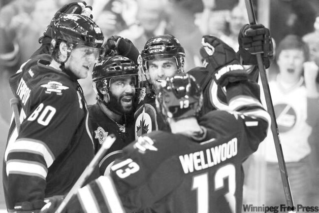 John Woods / the canadian press archivesWinnipeg�s Andrew Ladd (rear), Johnny Oduya (centre), Nik Antropov (80) and Kyle Wellwood celebrate a goal during a textbook win over Tampa Bay on Monday.