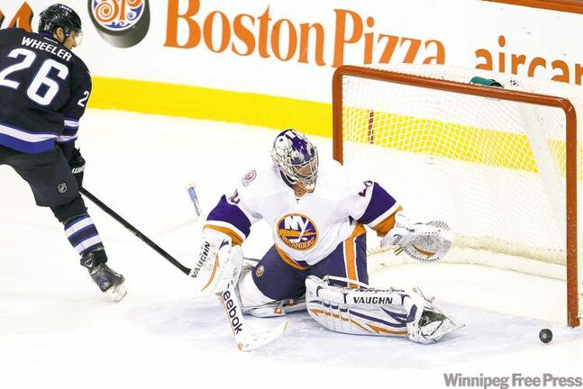Jets forward Blake Wheeler lost control of the puck and it trickled harmlessly wide of Islanders goalie Evgeni Nabokov during Tuesday night's shootout.