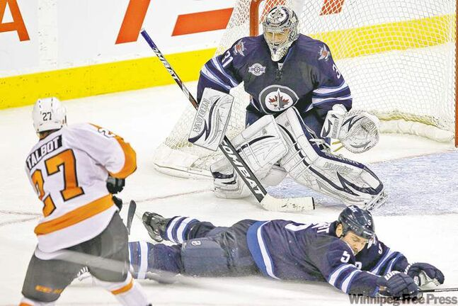 John Woods / WINNIPEG FREE PRESS ARCHIVESThe Jets have improved exponentially in the penalty-killing department, and a lot of that is thanks to Mark Stuart�s 107 blocked shots, like this one vs. Philadelphia.