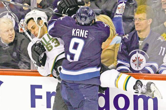 john woods / the canadian pressAttorney General Andrew Swan, wearing Jets jersey No. 11, approves of the hit Jets forward Evander Kane lays on Mike Ribeiro of the Dallas Stars during NHL action in Winnipeg on Wednesday.