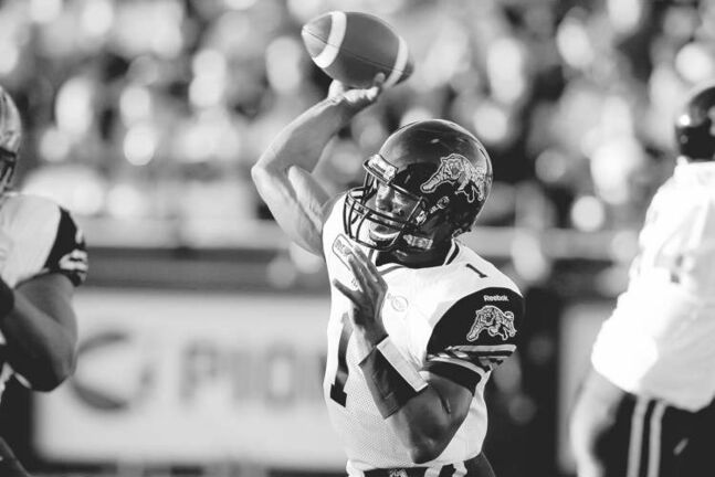 Hamilton Tiger-Cats quarterback Henry Burris passes during first half CFL pre-season action in Hamilton on Wednesday June 13 , 2012. THE CANADIAN PRESS/ Chris Young