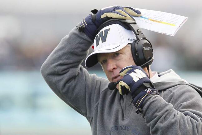 Winnipeg Blue Bombers' head coach Tim Burke adjusts his headset during the first half of their CFL game against Montreal Alouettes in Winnipeg on Saturday.