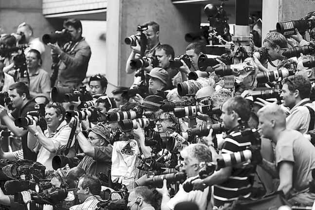 Photographers congregate at St. Mary�s Hospital in London Tuesday.
