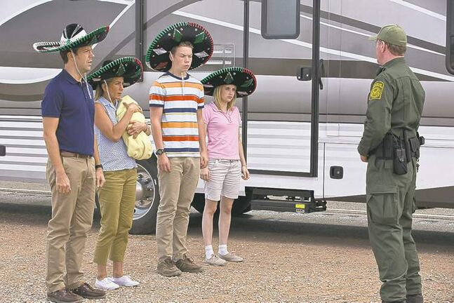 From left, Sudeikis, Aniston, Poulter and Roberts try to talk their way out of trouble in Mexico.