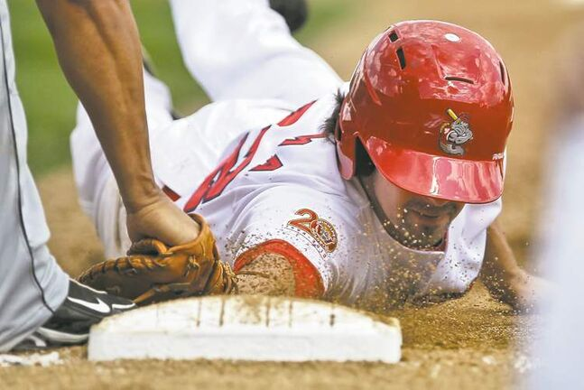 Goldeyes' Ryan Scoma (32) is tagged out after getting caught leading off first base in the bottom of the fifth of the conclusion of Saturday's rain-delayed game Sunday.
