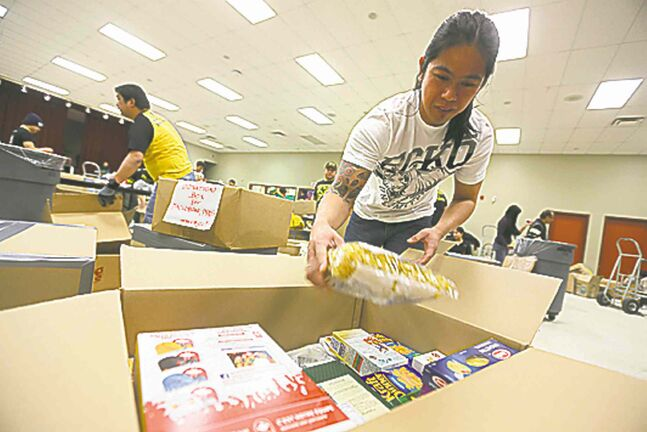Vic Gaurin packs aid for typhoon victims.