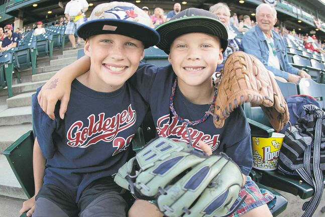 Brothers Matthew and Nathan Brown get right into the spirit of the American Association's all-star skills competition Monday at Shaw Park.
