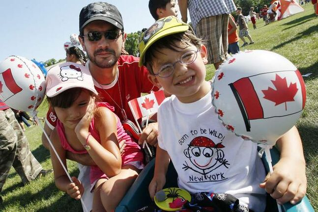 J.P. Thone with children Alexandra and Gabriel out celebrating Canada Day at Assiniboine Park.
