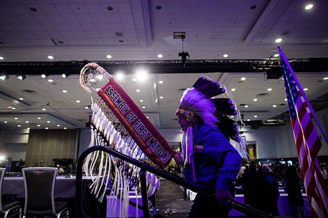 Assembly of First Nations National Chief Perry Bellegrade carries the eagle staff as he walks onto the stage for the opening of the AFN Annual General Assembly, in Vancouver on Tuesday, July 24, 2018. THE CANADIAN PRESS/Darryl Dyck