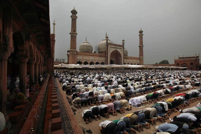Indian Muslims pray at the Jama mosque on the first Friday of Ramadan in New Delhi, India. Muslims throughout the world are marking the holy month of Ramadan, where observants fast from dawn till dusk. (AP Photo/Rajesh Kumar Singh)