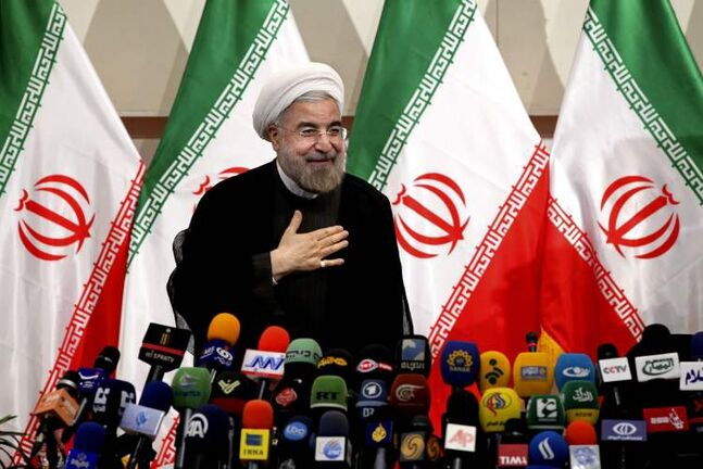 Iranian newly elected President Hasan Rowhani, places his hand on his heart as a sign of respect, after speaking at a press conference, in Tehran, Iran, Monda. Rowhani showcases his reformist image by promising a
