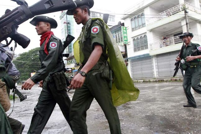 Myanmar soldiers patrol in a street in Sittwe, capital of Rakhine state in western Myanmar, on Friday, June 15, 2012. The communal violence that swept through Rakhine over the past week killed dozens of people.