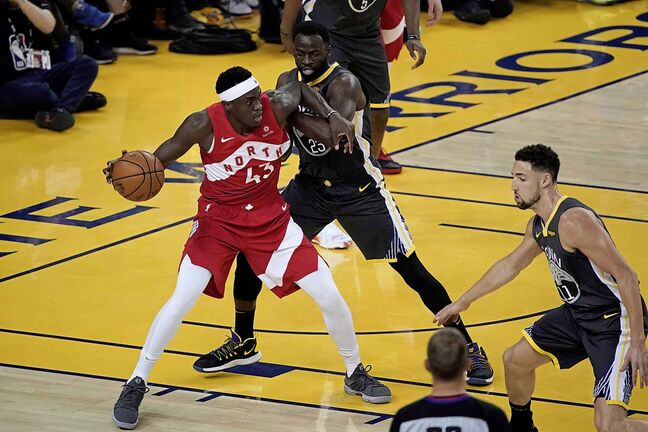 Toronto Raptors forward Pascal Siakam (43) is defended by Golden State Warriors forward Draymond Green during the first half of Game 6.