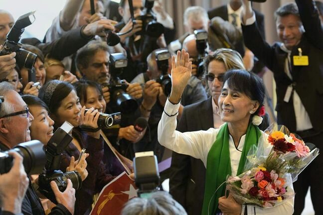 Aung San Suu Kyi, the Myanmar opposition leader, waves as she arrives at the 101st International Labor Organization, ILO, Conference at the European headquarters of the United Nations in Geneva, Switzerland, Thursday, June 14, 2012. Suu Kyi will visit Switzerland, Norway, Ireland, Britain and France from June 13  to June 29.