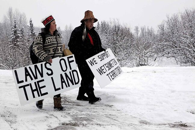 Todd Nelson and Christy Brown from the Nisga'a Nation arrive in support of the Unist'ot'en camp and Wet'suwet'en First Nation gather at a camp fire off a logging road near Houston, B.C., on Wednesday.
