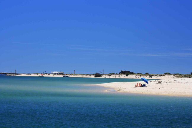 Ilha Deserta, an island in Faro, off Portugal,s southern coast. The scenic island, which is reachable by ferry, has a white sand beach, nature trail and lighthouses.