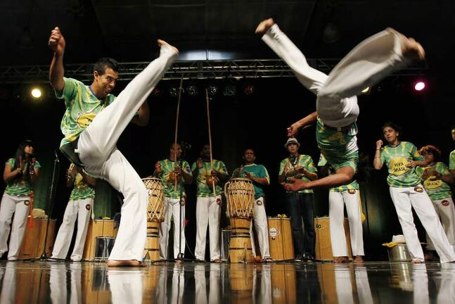 Viva Brazil perform Capoeira in the Brazilian pavilion.