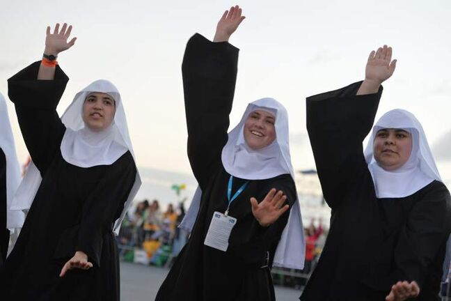 Nuns dance as they wait for the start of a a vigil on Copacabana beach in Rio de Janeiro, Brazil, July 27. Pope Francis drew faithful to Rio's Copacabana beach for the final evening of World Youth Day, hours after he chastised the Brazilian church for failing to stem the