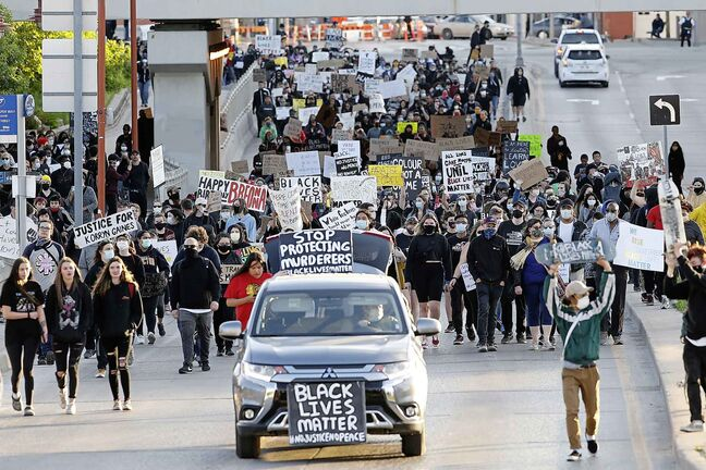 People march in solidarity with the George Floyd protests across the United States in Winnipeg, Friday, June 5, 2020. THE CANADIAN PRESS/John Woods