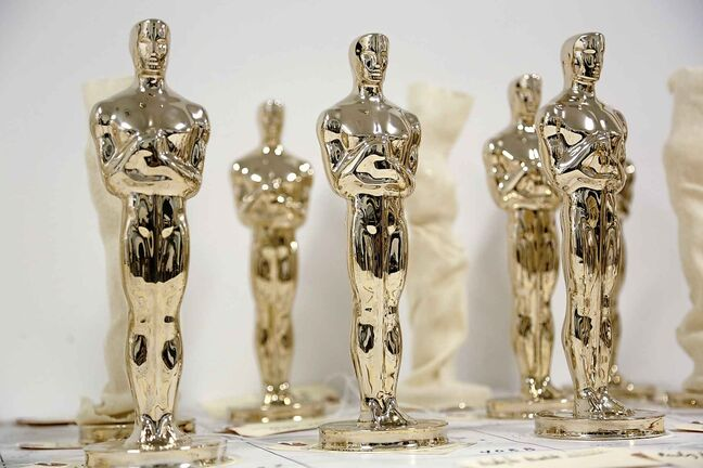 Every Oscar fist-pumped or tearfully cradled by Academy Award winners is first cast, buffed and fussed over by people far from Hollywood who spend several months making dozens of identical gold Oscars. (Seth Wenig / The Associated Press)