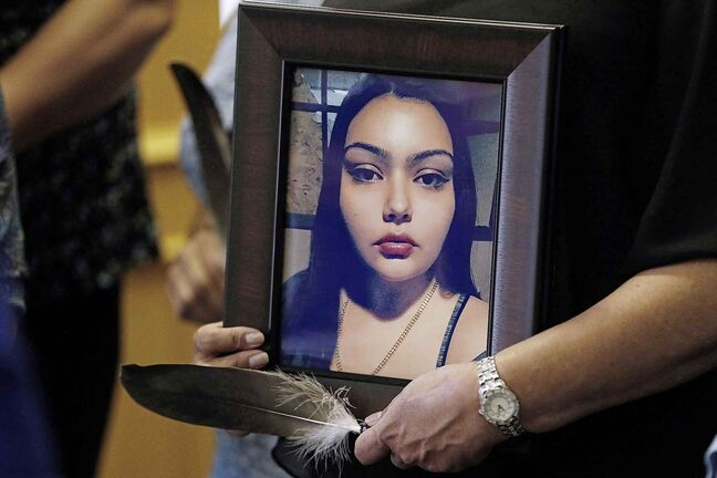 Delores Daniels holds a photo of her daughter Serena McKay who was murdered three months ago in Sagkeeng during a press conference calling for a re-organization of the National Inquiry into Missing and Murdered Indigenous Women and Girls (MMIWG) in Winnipeg, Wednesday, July 12, 2017. A teenager who helped attack a young Manitoba woman and shared the footage of her bloody death has been sentenced to just over three years in jail. THE CANADIAN PRESS/John Woods
