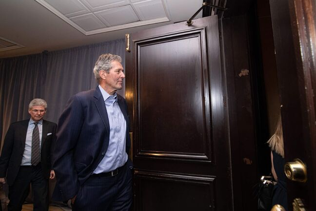 Brian Pallister heads into the East Ballroom of the Fairmont Hotel to meet with Prime Minister, Justin Trudeau during day 2 of the Liberal Cabinet Retreat in Winnipeg, Monday, Jan. 20, 2020. THE CANADIAN PRESS/Mike Sudoma