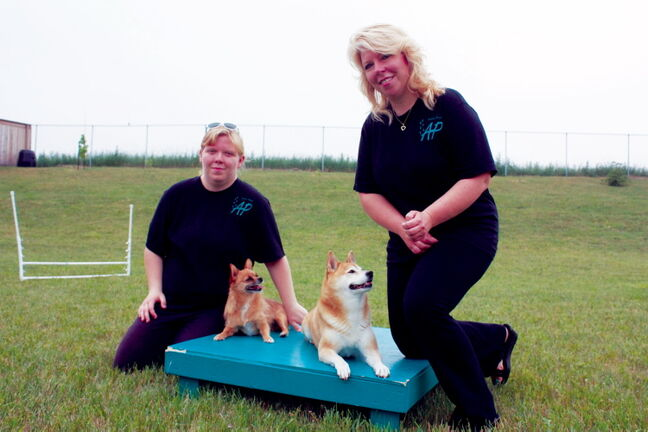 Miranda Jonasson and mother Karen, who are partners in Active Paws agility classes, are shown with dogs Shilah and Roxi at their Transcona home.
