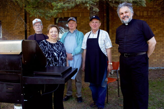 Anthony Hendricks, Shirley Skochylas, Morris Mazur, Don Tomchuk, and Fr. Michael Kwiatkowski cook up some burgers and hot dogs at the Holy Eucharist Ukrainian Catholic Church's community barbecue. Church members invited community members from neighbouring St. Alphonsus Roman Catholic Church, the Kildonan Horizons apartment block, and other local residents to mark the first annual National Week for Life and the Family (May 12 to 19), an initiative of the Canadian Conference of Catholic Bishops. Approximately 200 people attended.