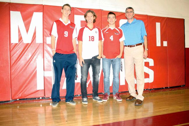 Mennonite Brethren Collegiate Institute Hawks players Ben Klassen, Joel Olfert, and Carter Bergen are shown with head coach Brian Plett. The Hawks are ranked No. 2 in the province.