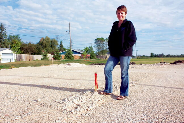 Oxford Heights Community Centre president Lora Deighton is shown in the midst of construction of a new basketball court at the club.