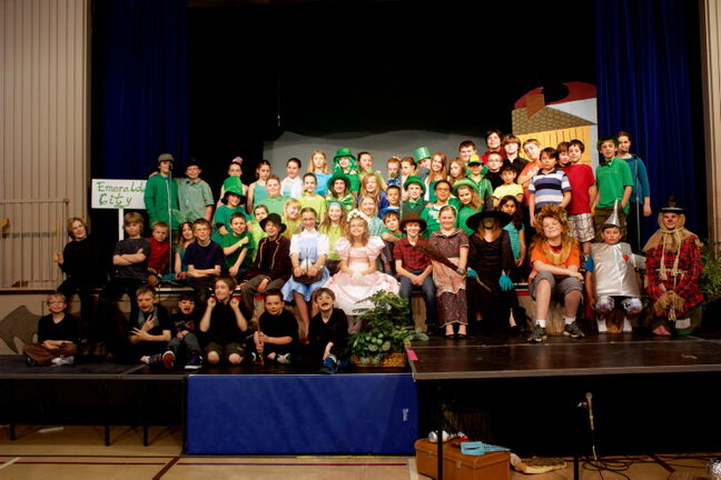 The cast of Springfield Heights School's production of The Wizard of Oz is shown.