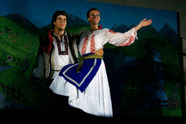 Performers pose after completing a dance at the Romanian Pavilion at Bronx Park Community Centre.