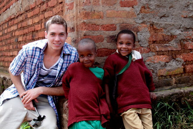 Kildonan-East Grade 12 student Garrett McEwen is shown with two Tanzanian youngsters during the school's trip to the country last month.