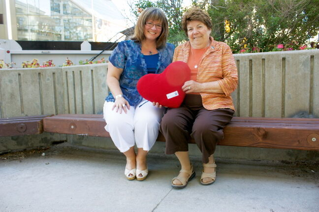 Fran Vannevel (right) has helped make over 3,000 pillows for heart patients in the city through MTS Volunteers. Vennevel is shown with MTS manager of community investment Roslyn Dally.