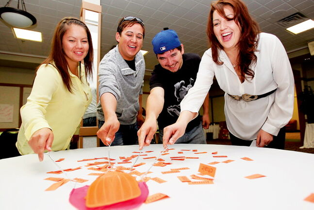 From left: Frontier College camp counselors Carly Turner, Brad Clearsky, Josh Choken and Brandy Turner play Site Word Slap during a literacy workshop. At a press conference on June 26, 2013  at the Canad Inns Transcona, Clint Davis, Vice President, Aboriginal Banking at TD Bank Group made an announcement that TD Bank is funding a literacy program at Frontier College to the tune of $100,000.