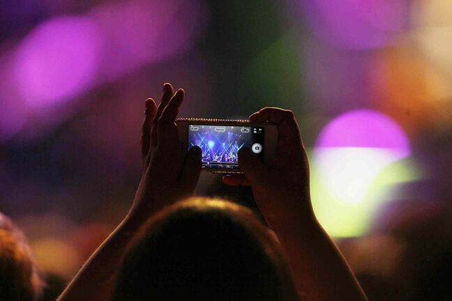 A fan records the Dixie Chicks in concert at the MTS Centre Tuesday.