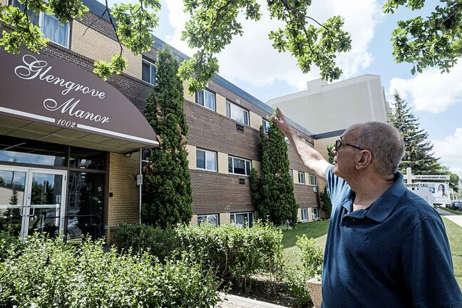 Daniel Crump / Winnipeg Free Press. Mark Paul stands outside the Grant Avenue apartment, where he lived in July 1982, when a 400 pound wheel from an airplane came crashing through the roof narrowly missing him. June 26, 2018.
