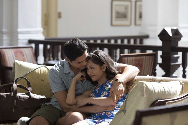 This image released by Warner Bros. Entertainment shows Henry Golding, left, and Constance Wu in a scene from