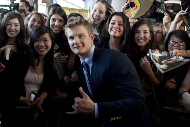 Alexander Ludwig poses with fans as he arrives on the red carpet for the premier the film
