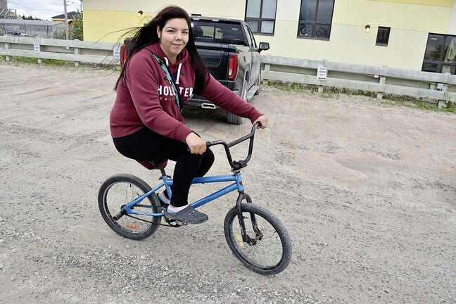 Ashley Lockhart, 16, biked around Gillam Thursday afternoon as things got back to normal for some residents of the small northern Manitoba town.
