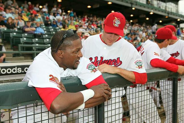 Winnipeg Goldeyes players Mike Coles and Nate Samson chat at Shaw Park before a game in June.  Samson is expected to join the Chicago Cubs' AA affiliate in Tennessee tomorrow.