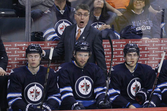 Winnipeg Jets' head coach Claude Noel disputes a call during the third period.